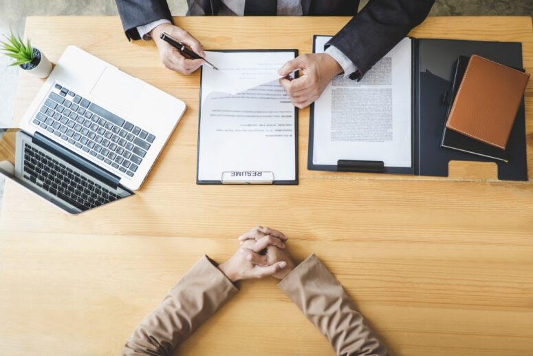 The resume of a candidate in the hand on an employer